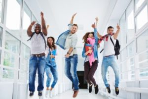 students celebrating their international student loans with no cosigner