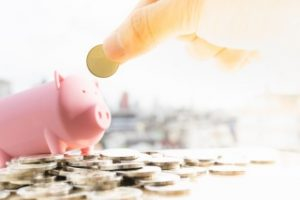 Piggy bank - student depositing their scholarship