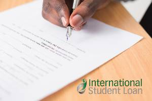Cosigner signing international student loan document